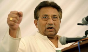 Musharraf and the famous fist. Photo T. Mughal/EPA