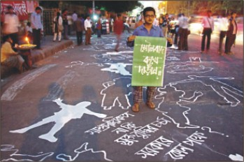 Arts Student paint protest grafiti against communalism